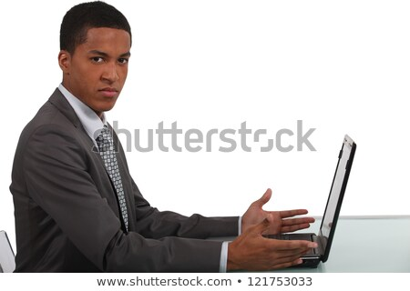 Man sat at table with computer Stock photo © photography33