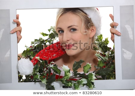 Christmassy woman inside a television set Stock photo © photography33