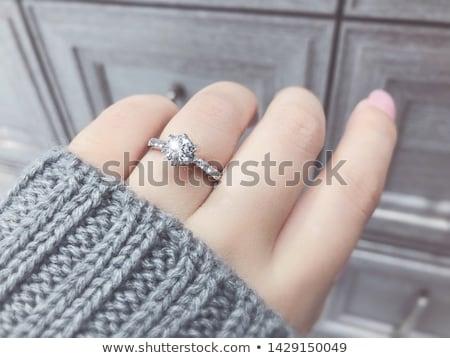 Kéz esküvő gyémánt eljegyzés gyűrűk pihen Stock fotó © Bertl123