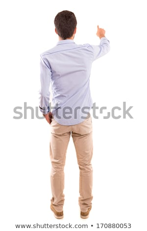 back view of a young casual man pointing his finger Stock photo © feedough
