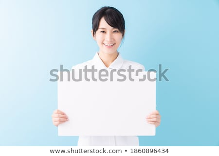 Young pretty woman with blank board isolated on white Stock photo © Elnur