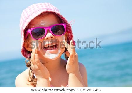 Homme lunettes de soleil plage soleil sable mer Photo stock © tannjuska
