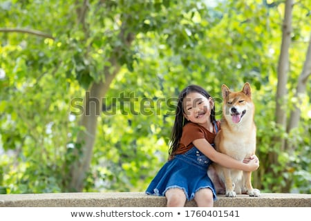 Stock photo: girl and puppy in the garden