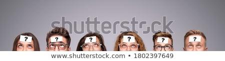 grave · hombre · gafas · de · sol · mirando · cámara - foto stock © stockyimages