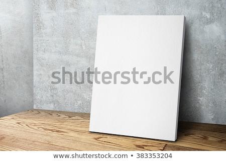 blank white poster mock up leaning on grunge studio wall stock photo © stevanovicigor