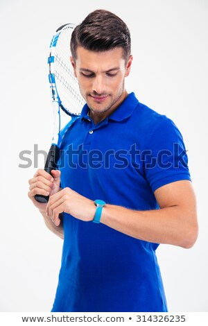 Female tennis player looking on fitness tracker Stock photo © deandrobot