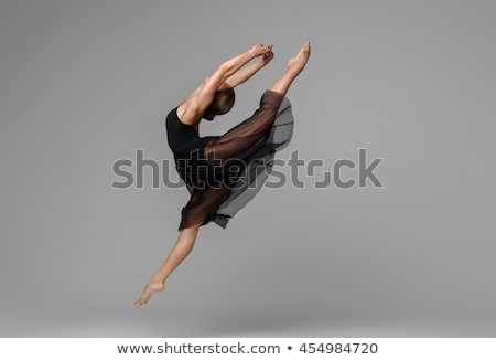 Beautiful female ballet dancer on a gray background Stock photo © master1305