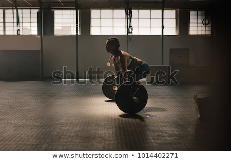 Fit female athlete doing heavy weight lifting Stock photo © Yatsenko