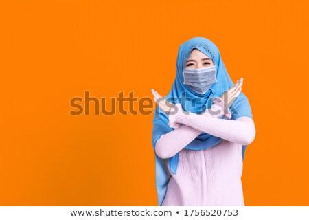 muslim woman in hijab showing stop sign Stock photo © dolgachov