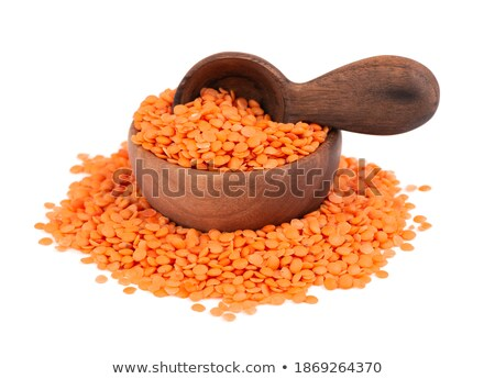 Bowl of red lentils porridge and spoon isolated. Healthy food fo Stock photo © MaryValery
