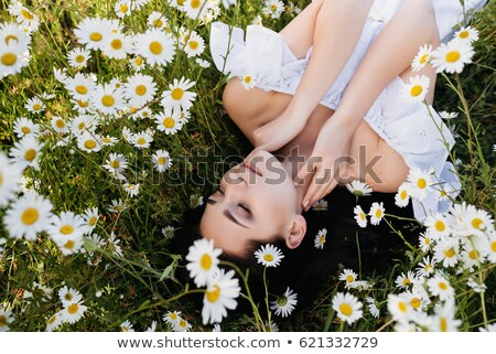 woman lying in garden with flower stock photo © is2