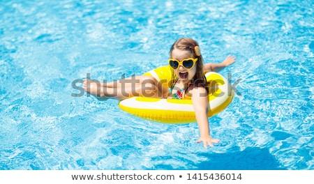 少女 インフレータブル リング ビーチ 夏 休暇 ストックフォト © IS2