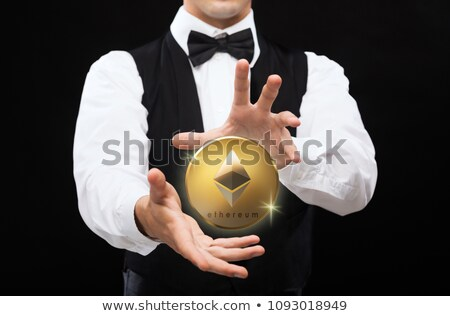 close up of magician with ethereum coin Stock photo © dolgachov