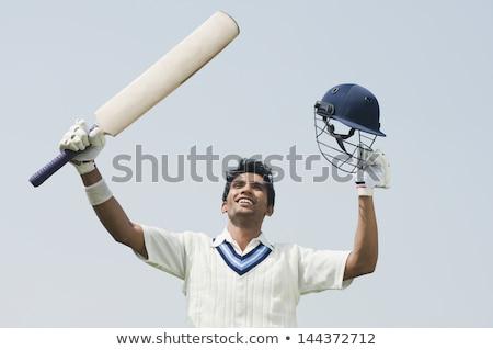 Cricket batsman celebrating his success Stock photo © Vicasso
