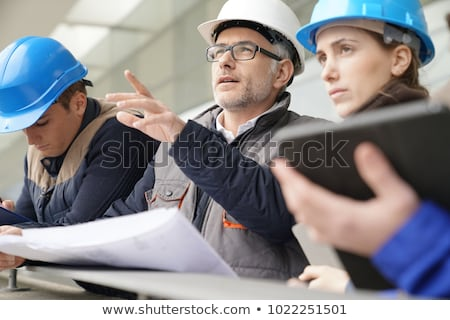 happy young woman working as architect in construction site stock photo © diego_cervo