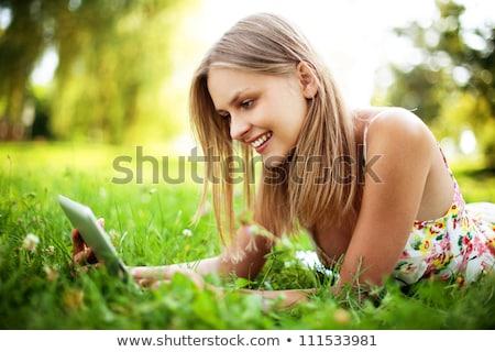 fiatal · nő · olvas · ekönyv · elektronikus · könyv · ül - stock fotó © boggy