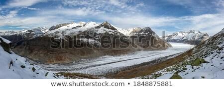 Suiza montanas cubierto nieve nubes naturaleza Foto stock © frimufilms