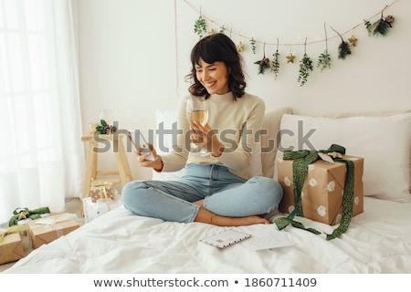 Woman holding wine glass sitting with family Stock photo © Kzenon