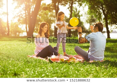 Woman on Picnic on Blanket, Child with Balloons Stock fotó © robuart