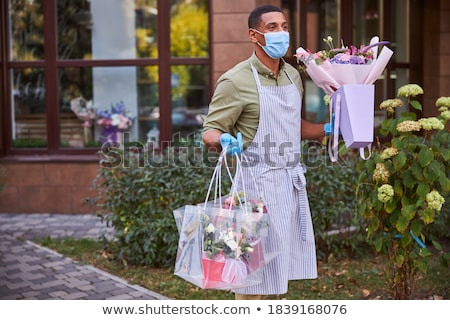 Man with Flowers in Hands Going to Deliver Bouquet Stock photo © robuart