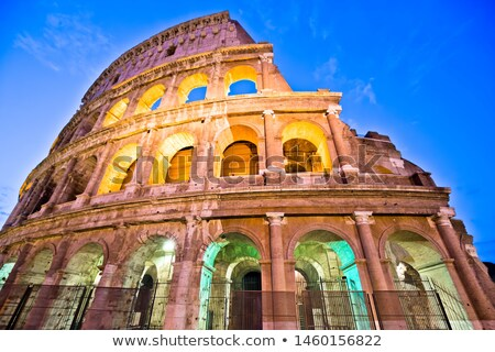 Majestic Colosseum of Rome evening colorful view Stock photo © xbrchx
