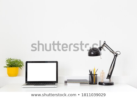 Office yellow backdrop with supplies and potted plant Stock photo © karandaev