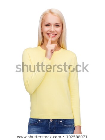Shh... Teenager with finger on her lips Stock photo © stockyimages