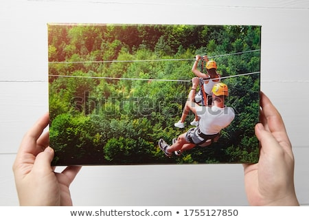 Woman holding brightly colored zips stock photo © photography33