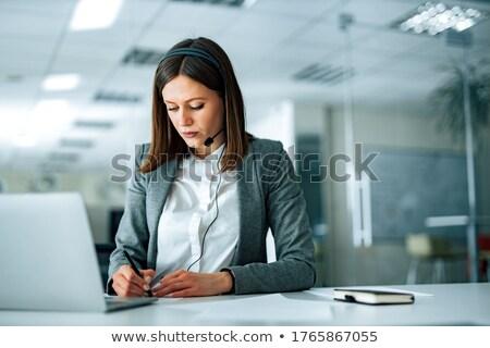 secretary wearing headset and taking notes Stock photo © photography33
