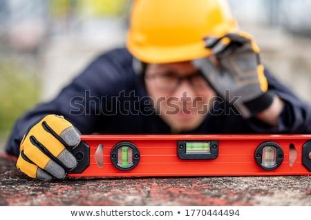 Artisan niveau construction industrielle blanche Photo stock © photography33