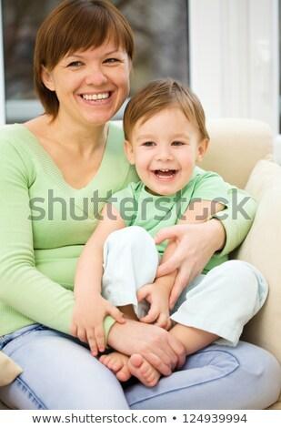 диване · портрет · ребенка · весело · цвета - Сток-фото © konradbak