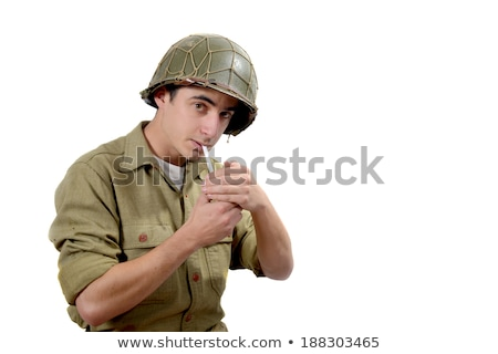 American soldier   lights a cigarette Stock photo © philipimage