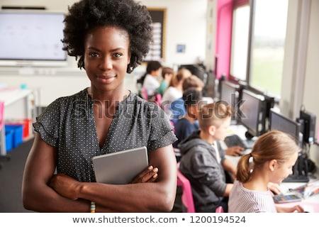 Stok fotoğraf: öğretmen · dijital · tablet · okul · büro