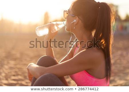 nő · bikini · üveg · ital · tengerpart · nyár - stock fotó © deandrobot