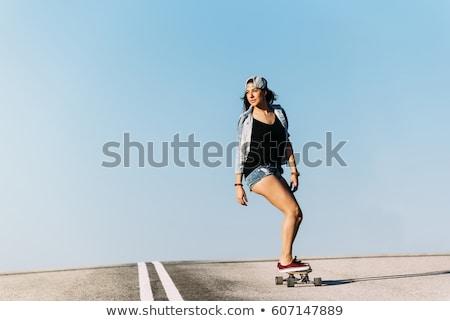 Stylish teenager riding a longboard  Stock photo © bezikus