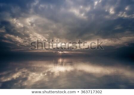Calm seascape with stormy sky. Stock photo © vapi