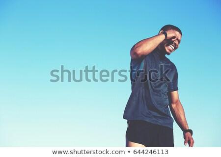 Seductive bodybuilder against black background Stock photo © wavebreak_media
