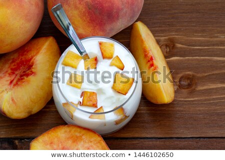 Yogurt melocotón desayuno griego frescos tazón Foto stock © YuliyaGontar