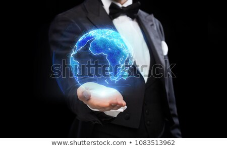 close up of magician with earth hologram Stock photo © dolgachov