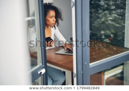 brunette cutie and her laptop stock photo © lithian