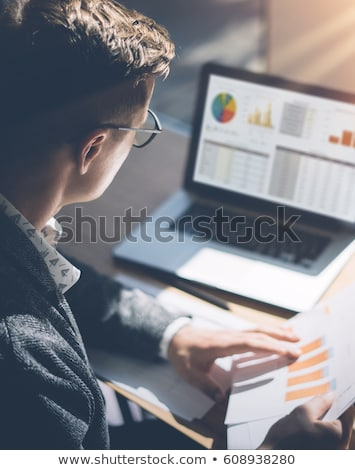 businessman analyzing the graph on laptop in the meeting stock photo © andreypopov