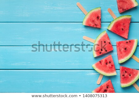 watermelon on wooden stick exotic food cream stock photo © robuart