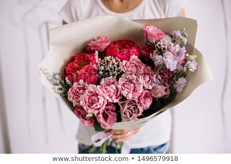 Happy Female Florist Holding Flower Bouquet Stock photo © AndreyPopov