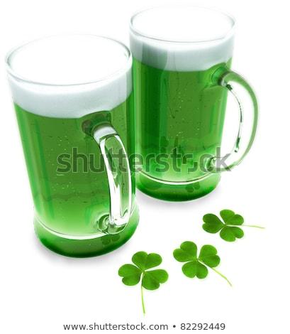 Közelkép üveg zöld sör shamrock Szent Patrik napja Stock fotó © dolgachov