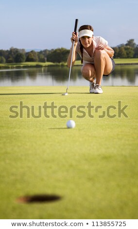 девушки · гольфист · улыбающаяся · женщина · зеленый · озеро - Сток-фото © lichtmeister
