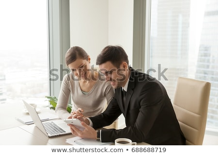Business woman working on tablet with secured cloud technology concept Stock photo © ra2studio