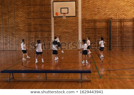 Сток-фото: Rear View Of Schoolkids Playing Basketball At Basketball Court In School