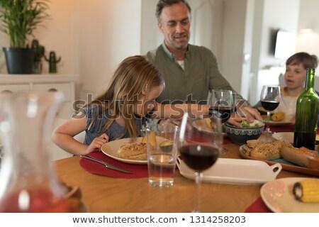 вид сбоку отец детей еды обеденный стол домой Сток-фото © wavebreak_media