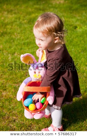 colored easter eggs on artificial grass Stock photo © dolgachov