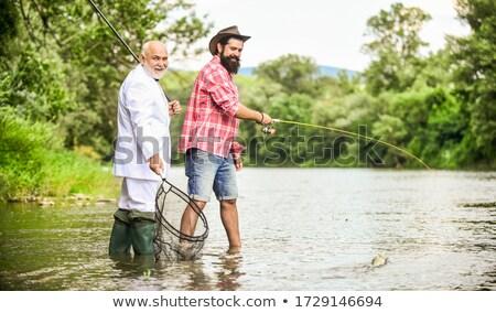 бородатый рыбак удочка пирс морем отдыха Сток-фото © dolgachov